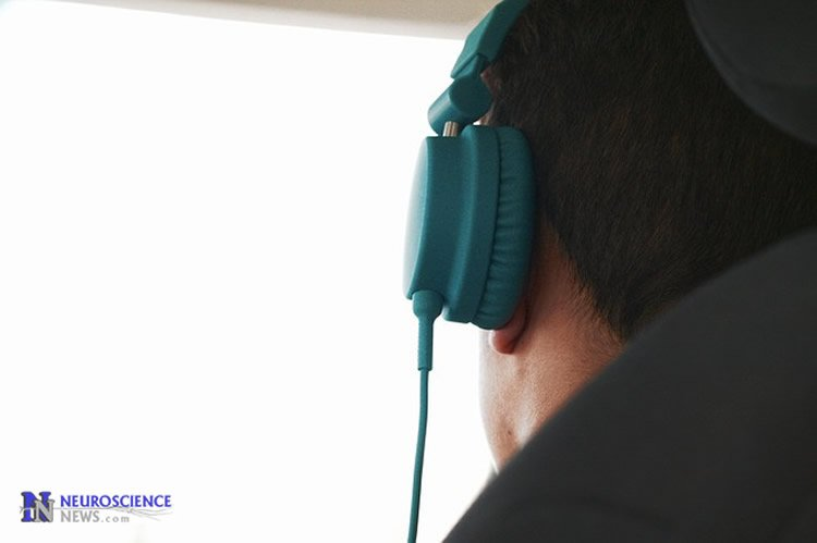 Photo of a man in headphones.