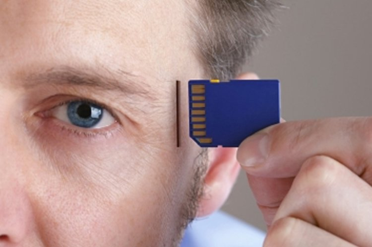 Image shows a man with an SD card.