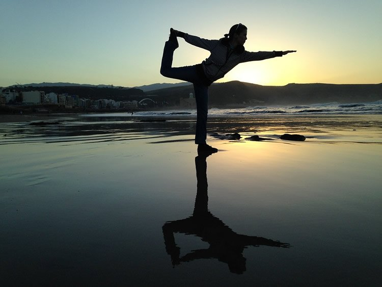 Image shows a woman in a yoga pose.