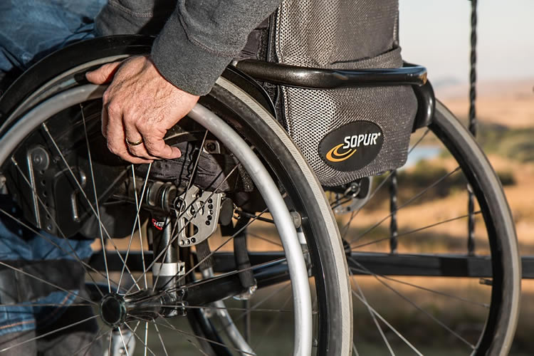 Image shows a wheelchair.