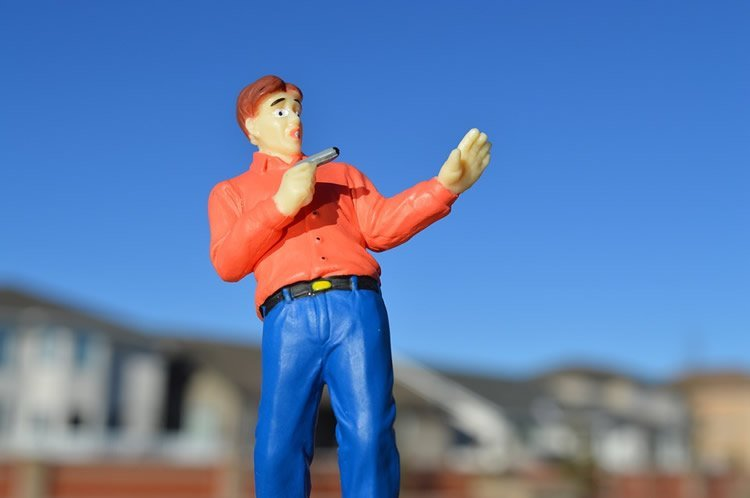 Image shows a plastic model of a man holding a gun.