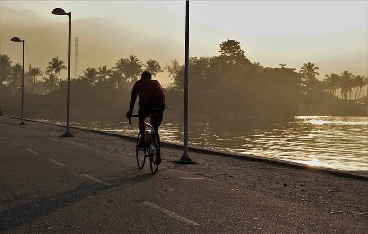 Image shows a man riding a bike.