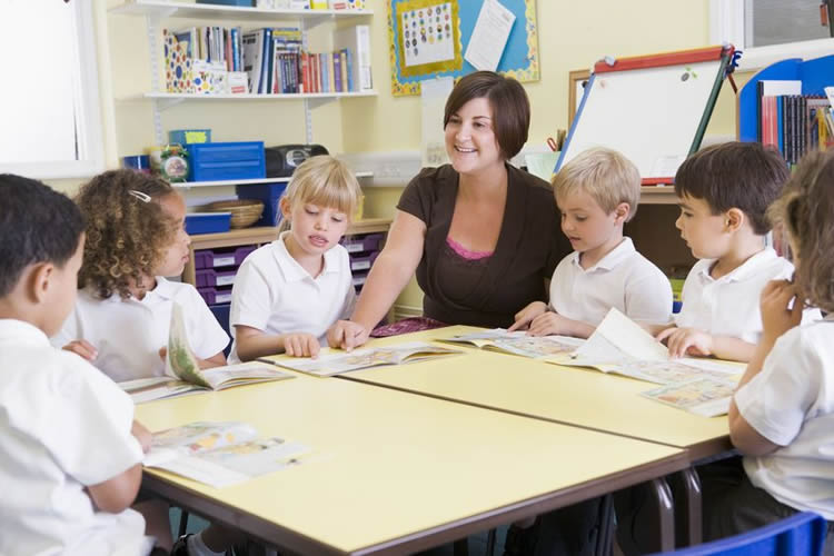 Image shows children and a teacher.