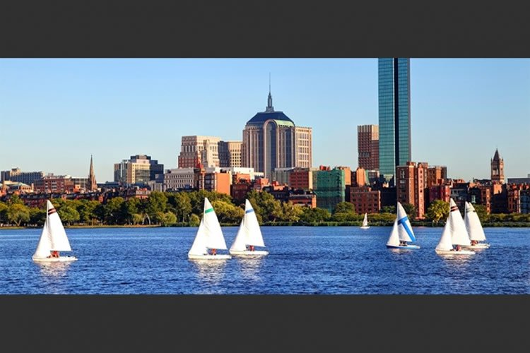 Image shows boats sailing on a river.