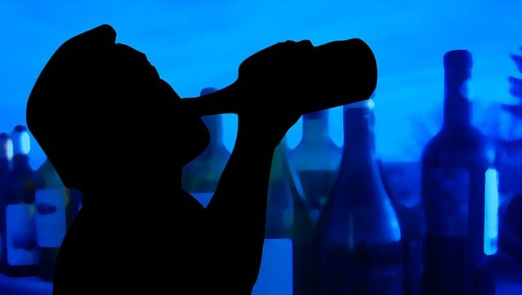 Image shows a person drinking.
