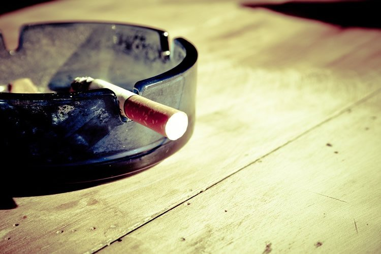 Image shows a cigarette in an ash tray.