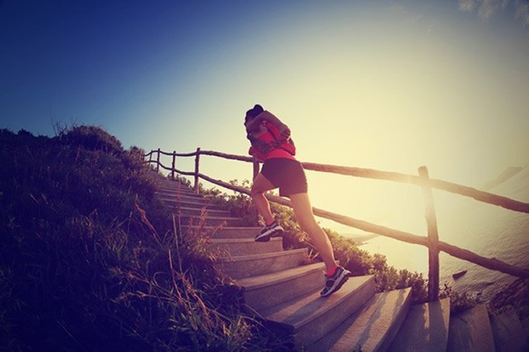 Image shows a person running up steps.