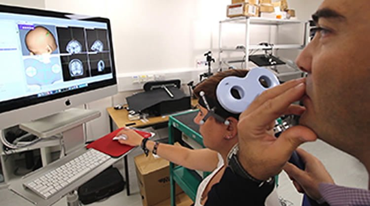 Image shows Dr Davare demonstrating the technique.