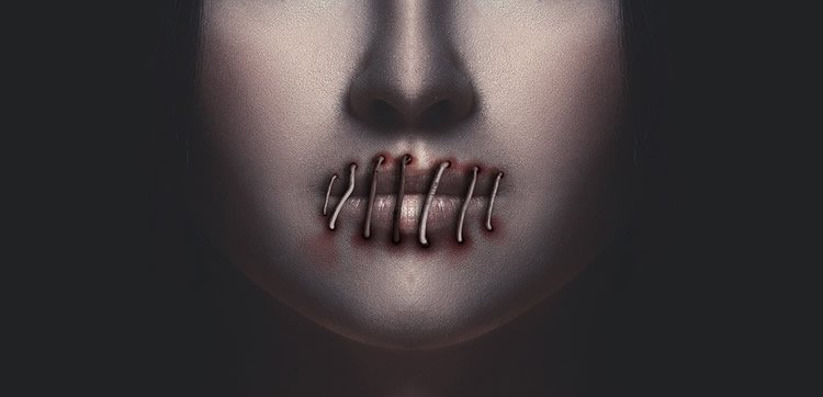 Image shows a sewn up mouth.