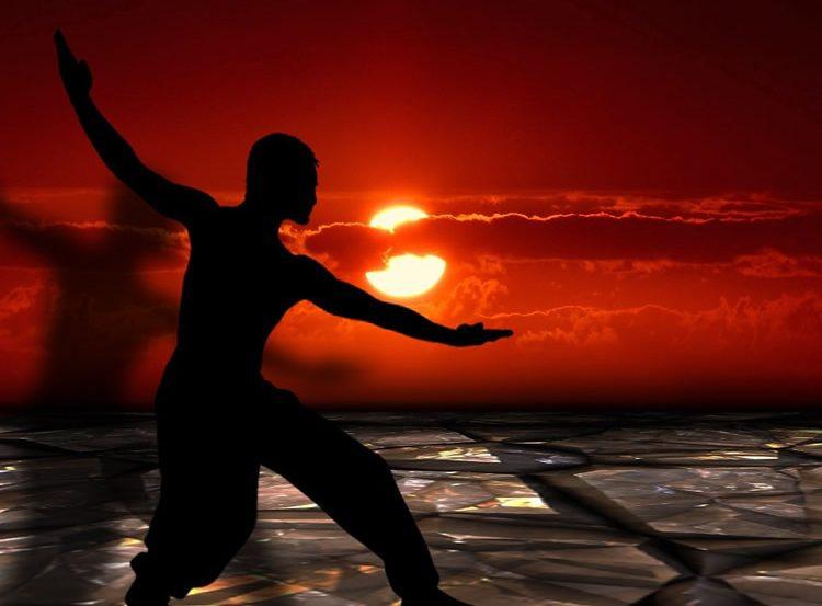 Image shows a person doing tai chi.