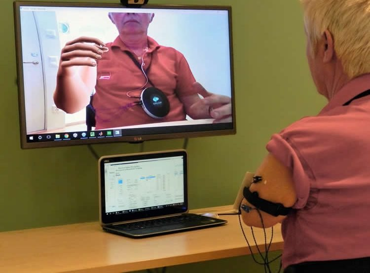 Image shows a person using the AR system.