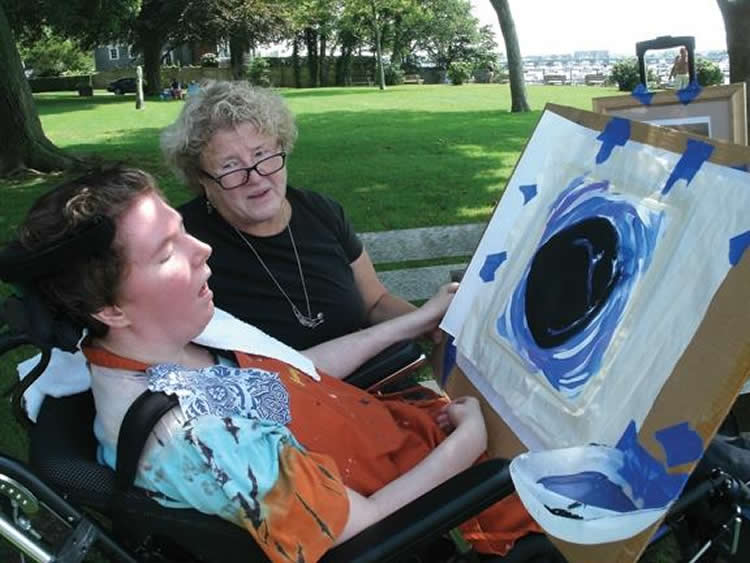 Image shows Nancy Worthen is doing art therapy with her daughter, Maggie, who was minimally conscious.