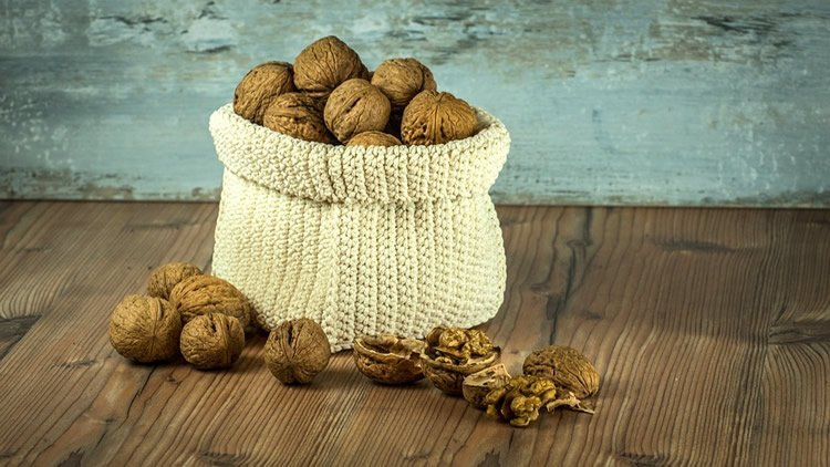 Image shows a bag of walnuts.