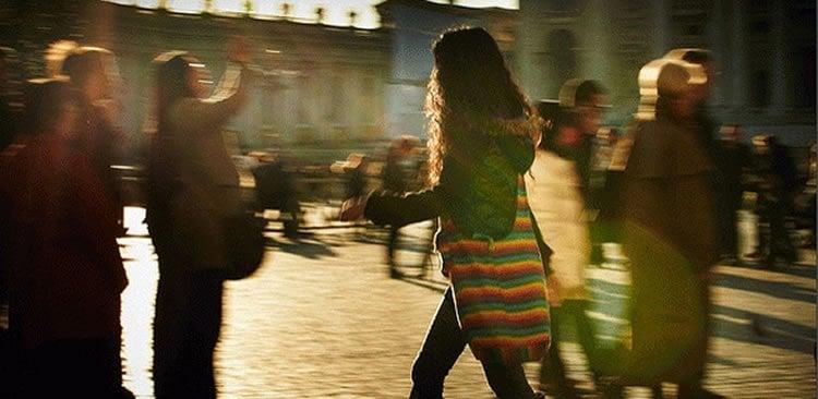 Image shows a woman walking.