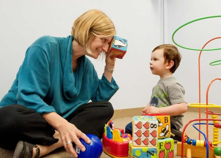 Image shows the researcher and a little boy.