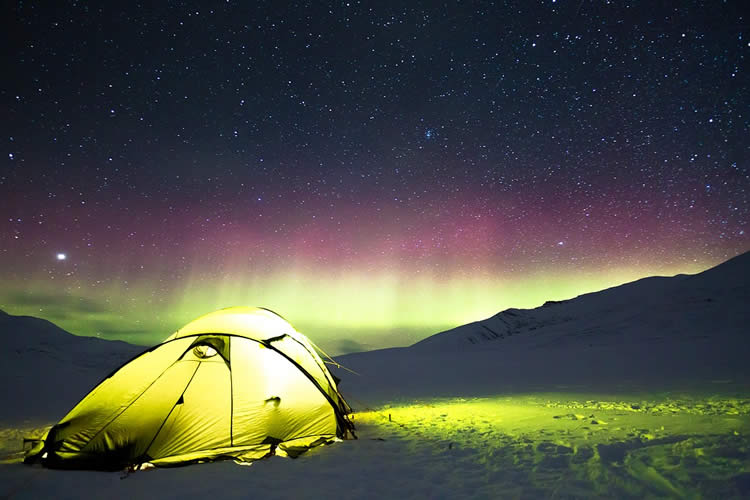 Image shows a tent and the night sky.