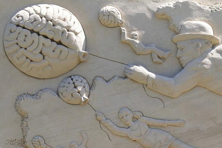 Image shows a brain sand sculpture.