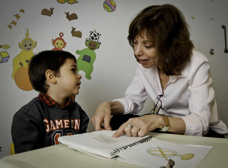 Image shows the researcher and a child.