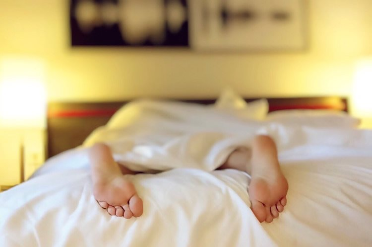 Image shows a person sleeping.