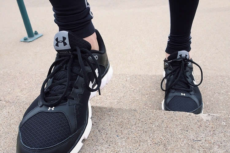 Image shows a pair of running shoes.