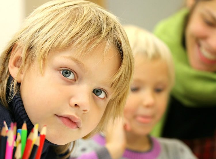 Image shows young children.