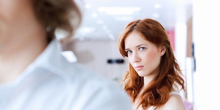 Image shows a woman looking man at a man.