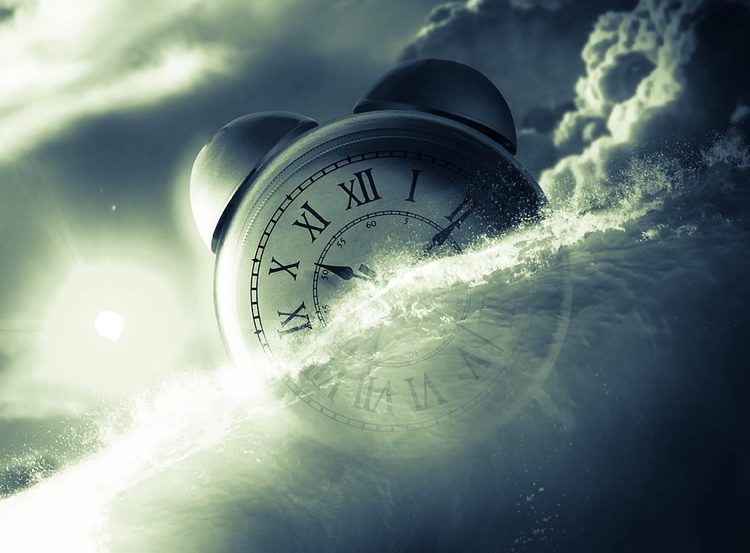 Image shows clouds and a clock.