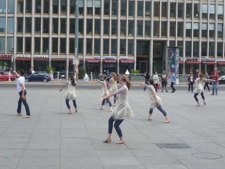 Image shows women performing tai chi.