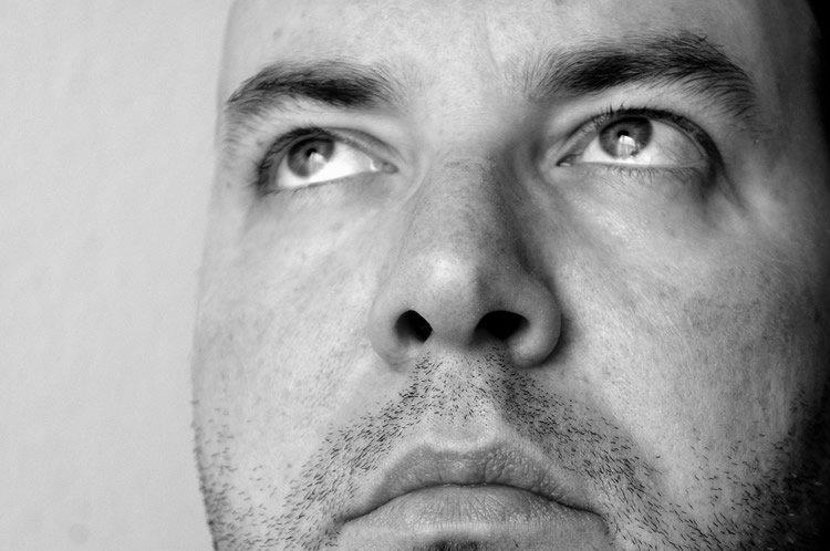 Image shows a man's face.
