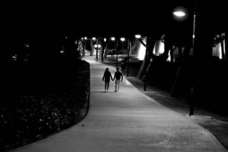 Image shows young couple holding hands.