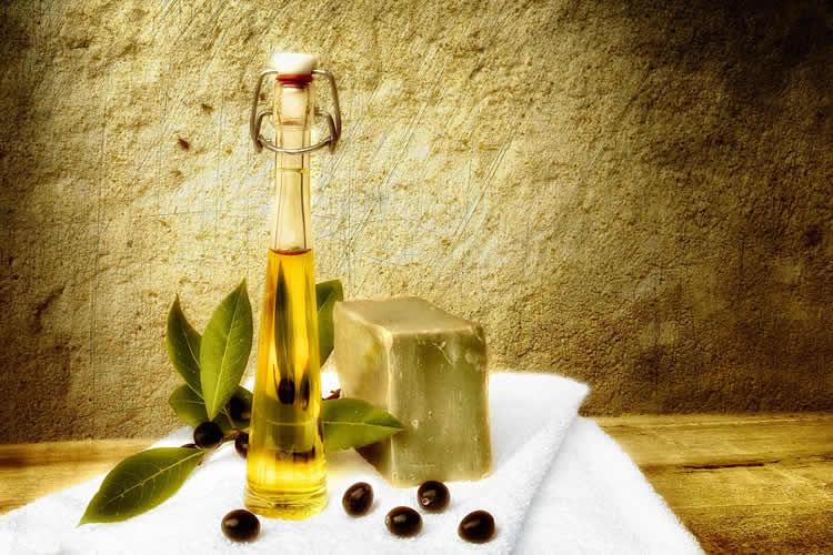 Image shows a bottle of olive oil.