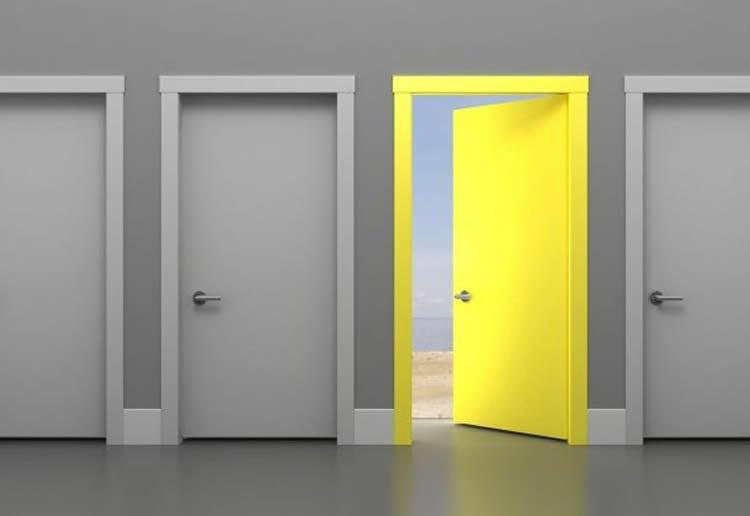 Image shows 3 gray doors and one open yellow door.