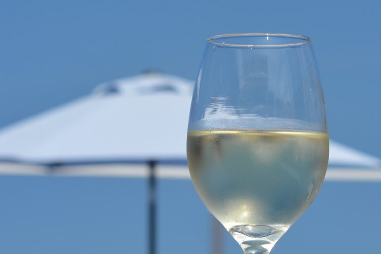 Image shows a glass of white wine.