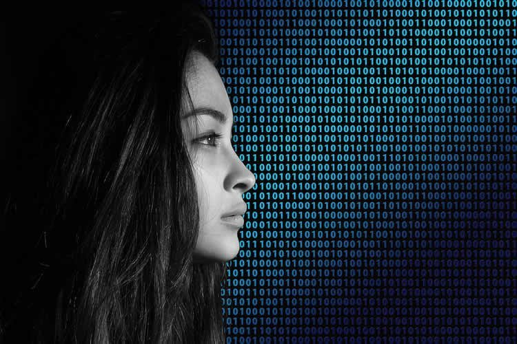 Image shows a woman and binary code.