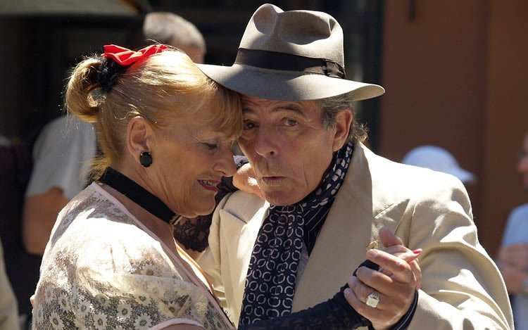 Image shows an old couple dancing.