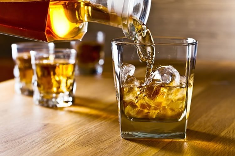 Image shows glass of whiskey.