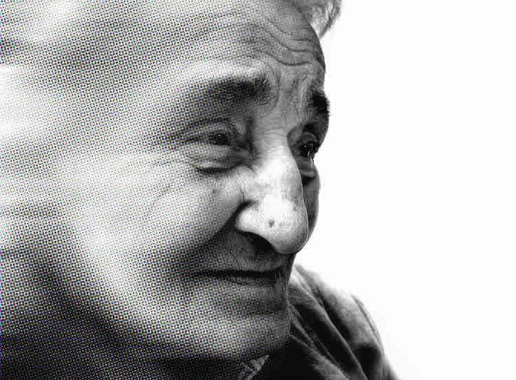This image shows the face of an older lady.