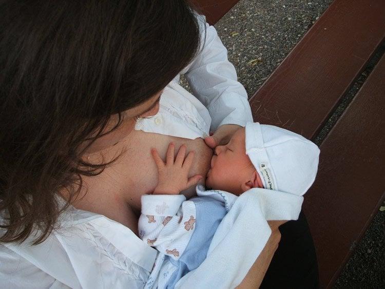 Image shows a mom breastfeeding a baby.
