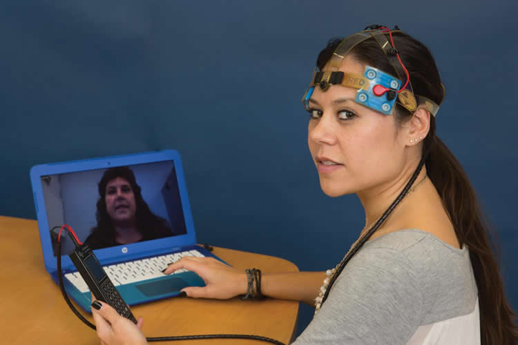 Image shows the researcher with the tdcs equipment.