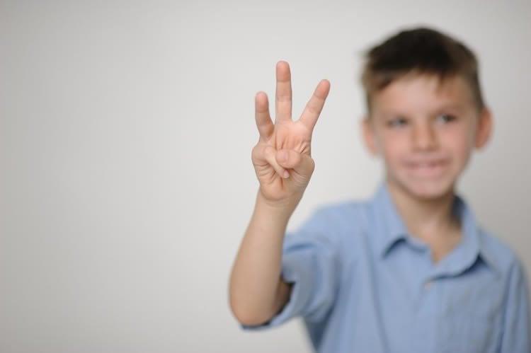 child holding fingers up
