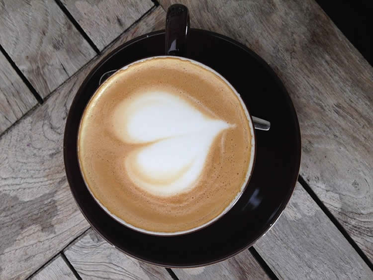 a cup of coffee with a heart in the foam