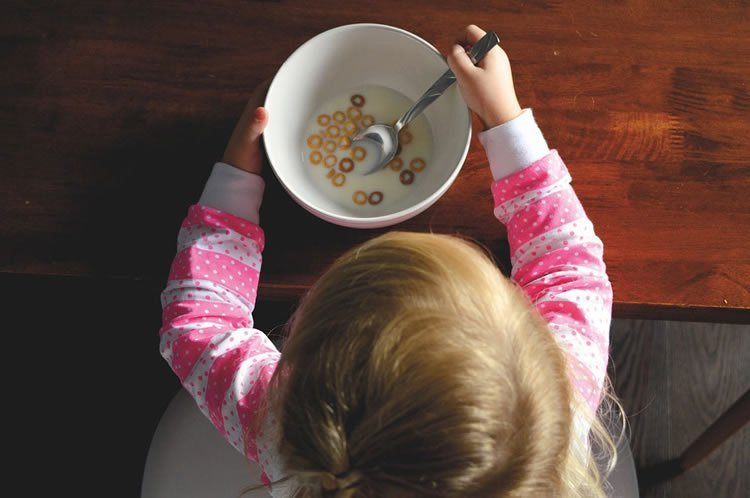 a child eating cereal