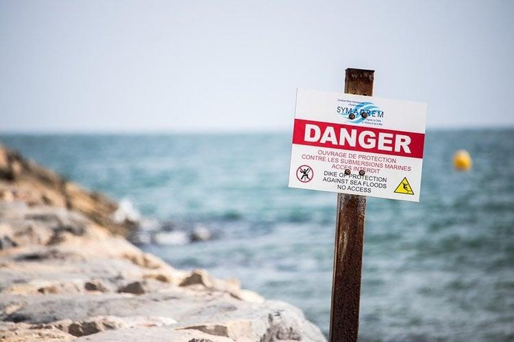 a danger sign on a beach