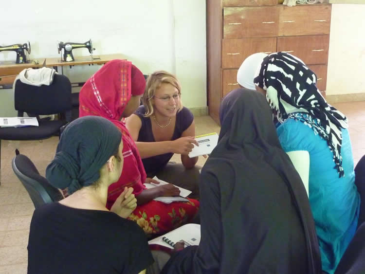 image shows the researchers with a group of women