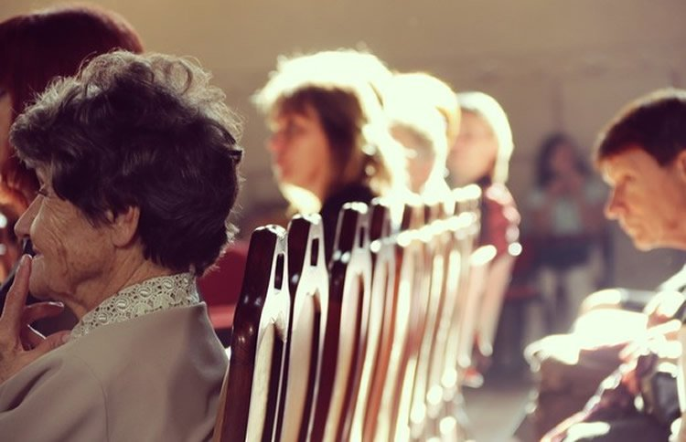 people sitting in a church