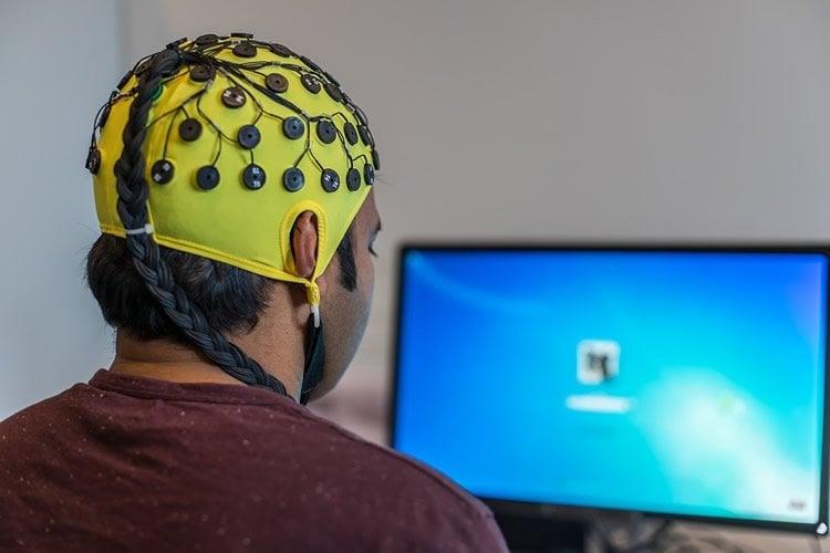 A MAN IN AN EEG CAP