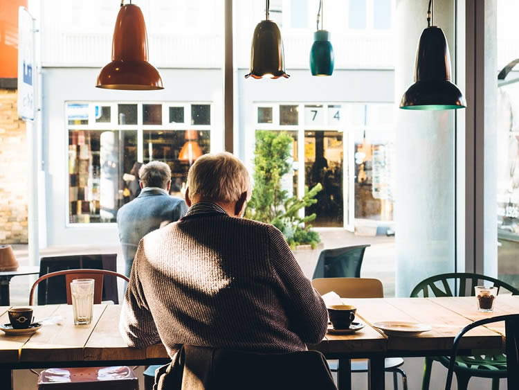 an old man in a cafe