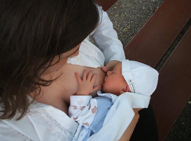 a mom breastfeeding a newborn