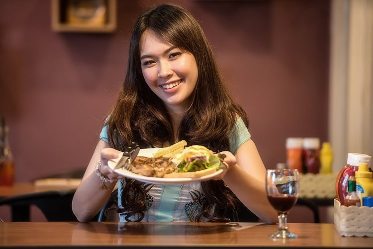a woman eating a plate of food