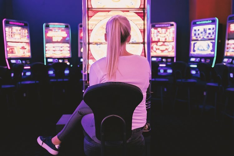 a woman sitting at a slot machine
